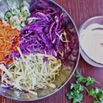 Friends and neighbors will rave over this tangy 10-ingredient Spicy Chipotle Coleslaw recipe at your next cookout. It's a south of the border inspired summer favorite perfect for piling on pulled pork, fish tacos, or jerk chicken sandwiches.
