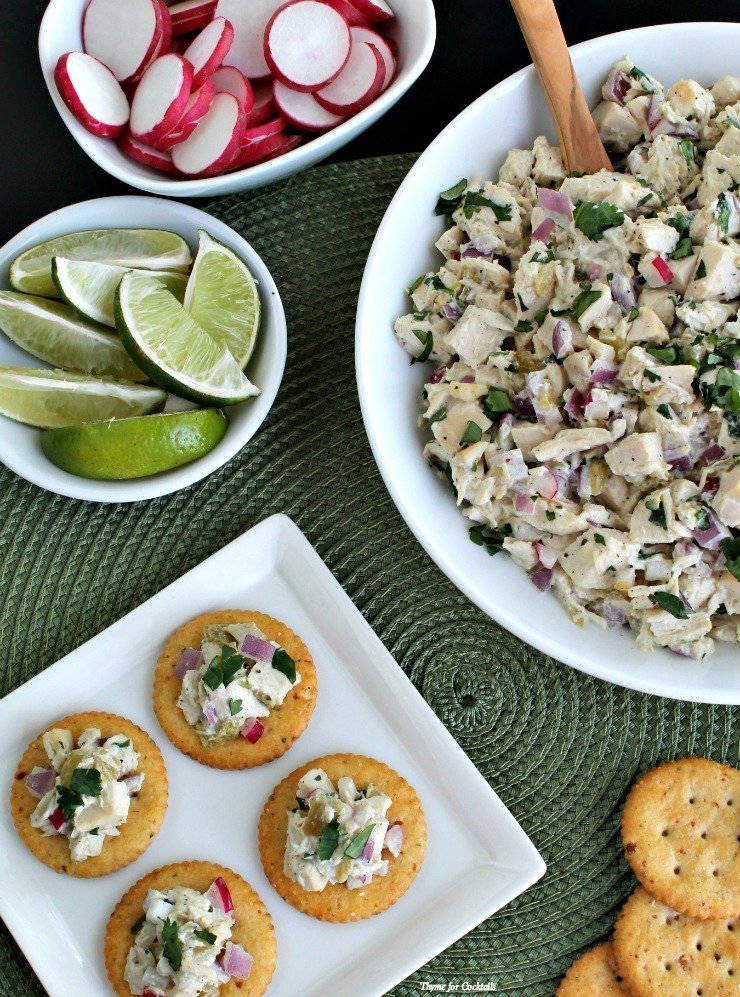Green Chile Chicken Salad on crackers with optional toppings - sliced radish, limes wedges, chopped cilantro