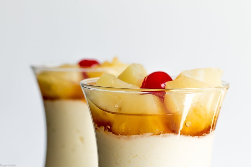 Whip up these no-bake Pineapple Upside Down Cheesecake Parfaits in a fraction of the time it takes to make the real thing.