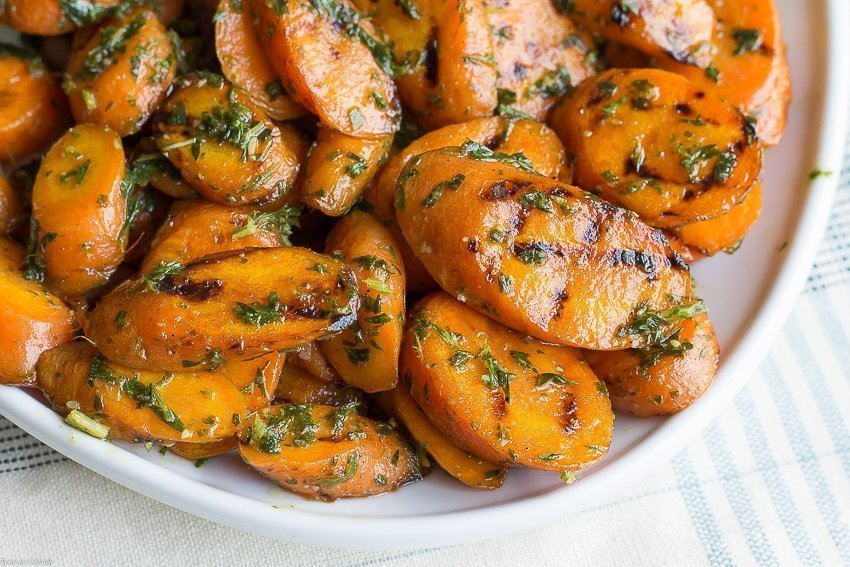 Practice sustainable, root to stem cooking when you make this Pesto Grilled Carrots recipe with hints of roasted garlic and fresh, bright lemon flavors.