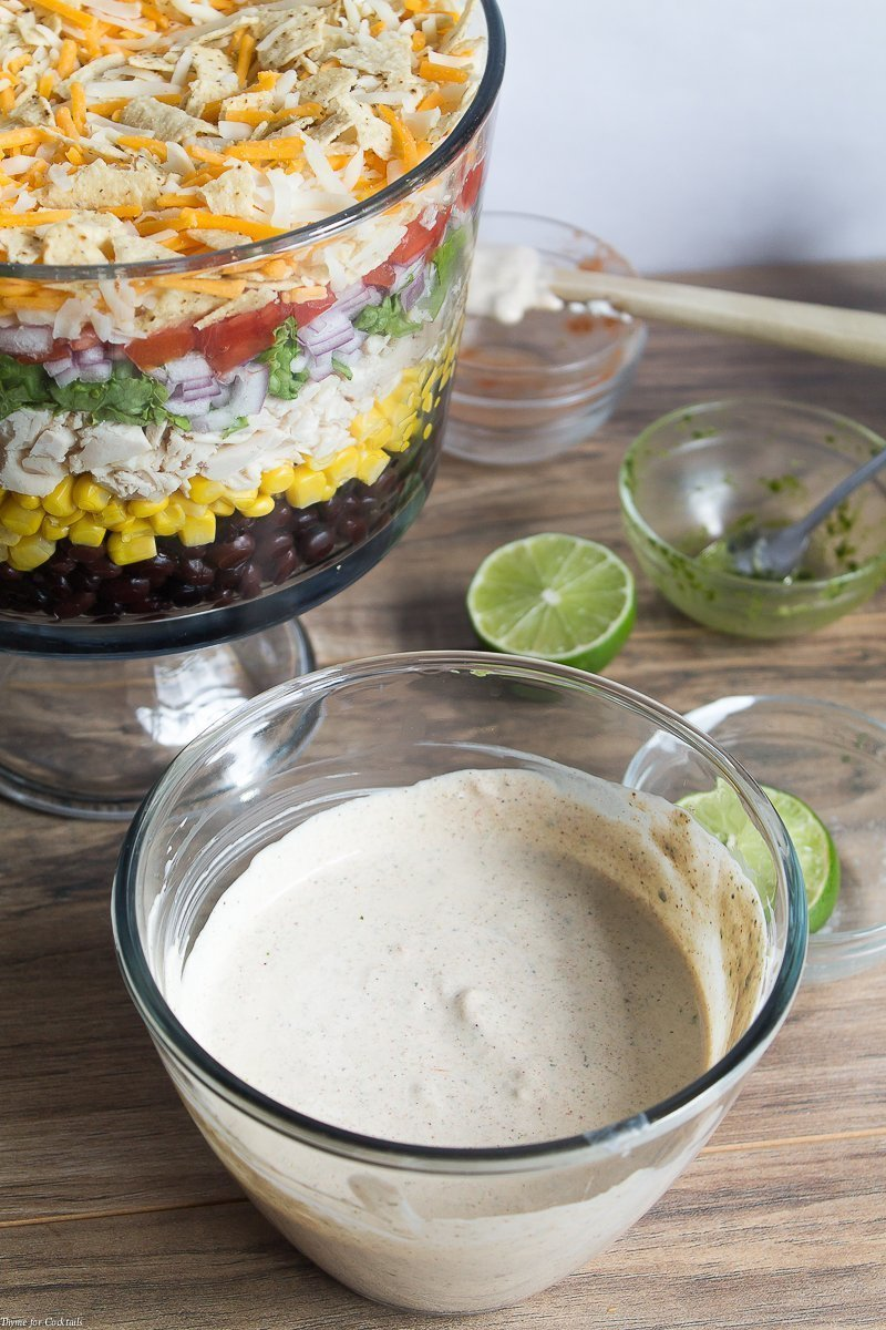 This easy to make Layered Chicken Taco Salad is full of tender chicken, fresh veggies, and a creamy Tex-Mex inspired dressing made with flavorful herbs.