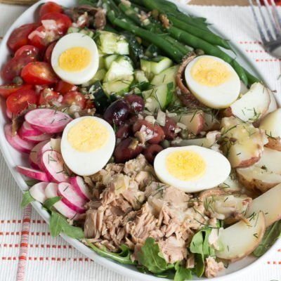 Enjoy eating a delicious lunch on relaxing summer days when you create this Classic Salade Niçoise Recipepaired with your favorite French wine.