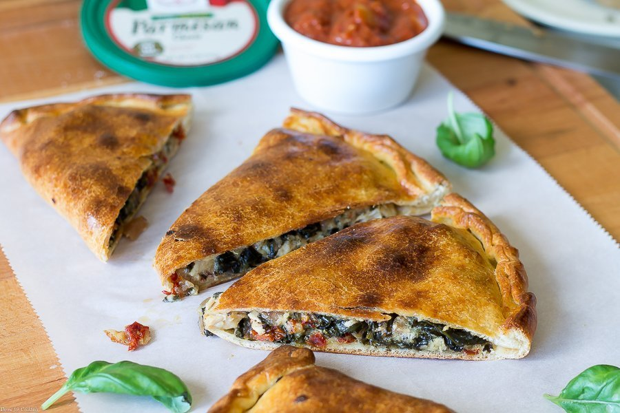 Every bite of this Sun Dried Tomato Basil Chicken Calzone recipe is so full of authentic Italian flavors you can't help but feel like you are dining in a classic pizzeria.