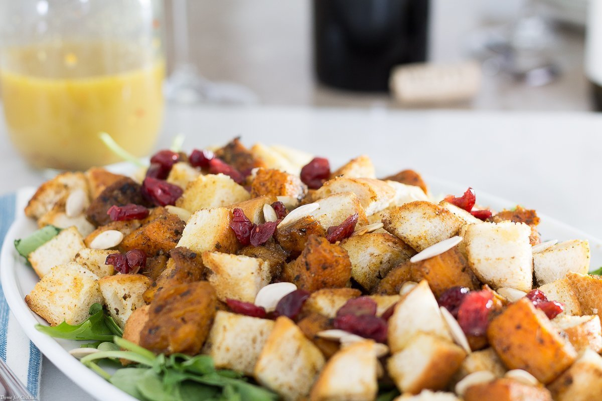 One bite of this Chipotle Butternut Squash Panzanella Salad tossed with a seasonal vinaigrette will make you glad you wore your stretchy pants to dinner.