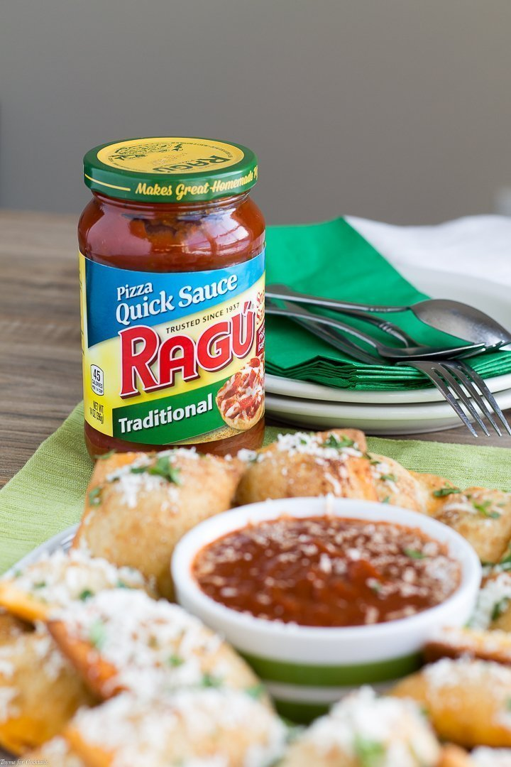 Ragu Quick Pizza Sauce with Homemade Sausage Pepperoni Pizza Rolls in front